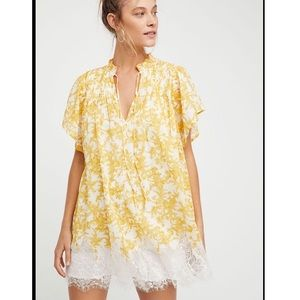 Free people yellow marigold dress with lace hem.